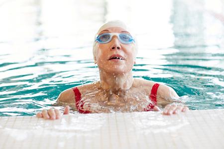 Enjoyment in swimming pool Stock Photo
