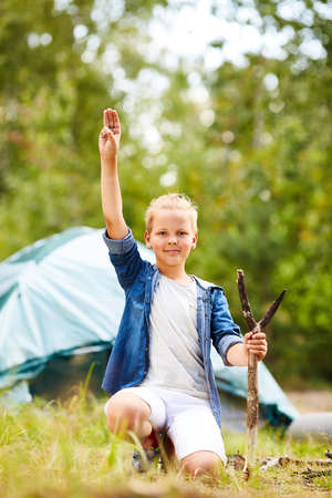 Boy scout preparing camp Stock Photo