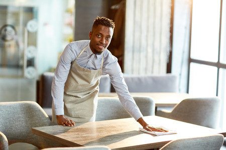 Waiter at work Standard-Bild