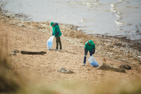Cleaning bank of river