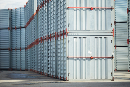 Stack of huge new metallic storage containers with closed doors 스톡 콘텐츠