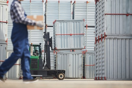 Load transportation machine with large container and worker carrying box