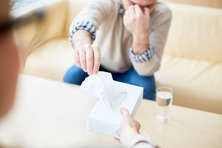 Crop man taking tissue from doctor Stock Photo