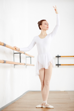 Adult ballerina with strict hairstyle staying in pose Imagens