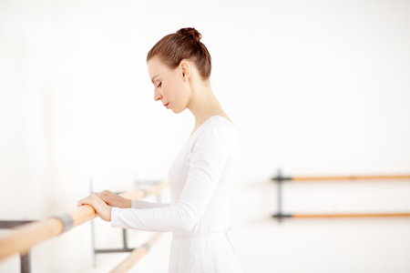Attractive woman staying in dancing school