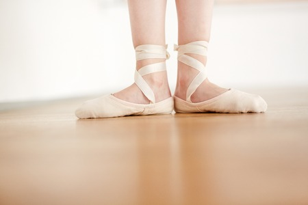 Female feet in pointe light color staying in position