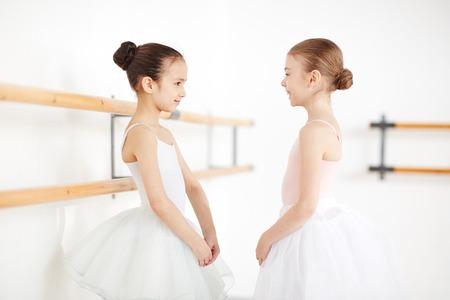 Little girls spending time together in dancing studio