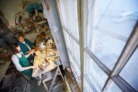 Women near workbench in carpenter workshop Stock Photo