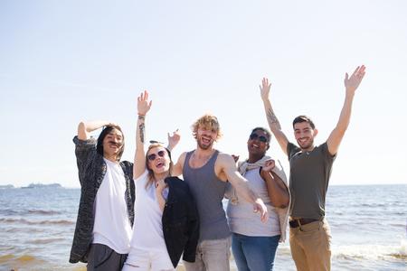 Diverse young people near sea Banco de Imagens