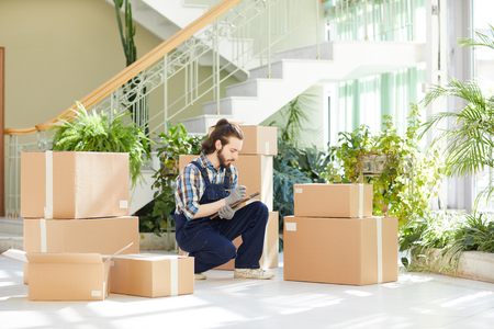 Busy moving manager responsible for inventory Stock Photo