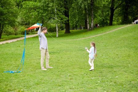Playing kite Фото со стока