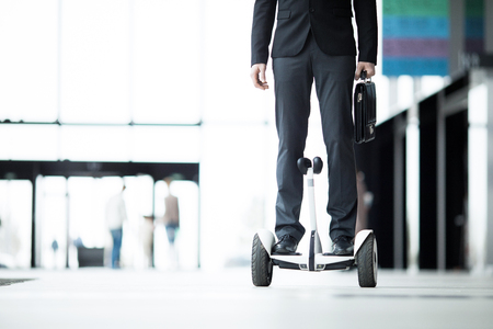 Businessman on hoverboard Stock Photo - 103635508