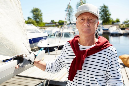 Senior man on yacht