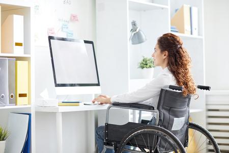 Office worker by desk