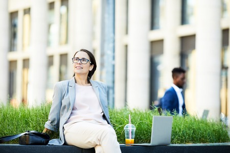 Lady resting outdoors during break Stockfoto