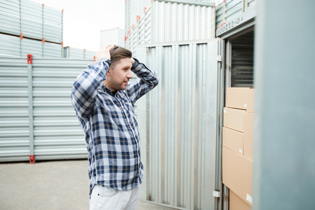 Distraught man at large container