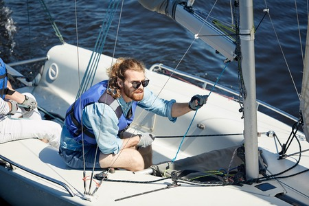 Focused man in sailboat