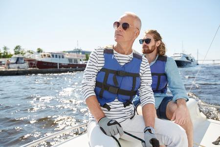 Tourists looking around during sailing tour Stockfoto - 104843929