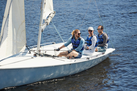 Men sitting on yacht deck 版權商用圖片