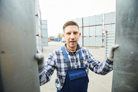 Shocked worker at cargo storage area