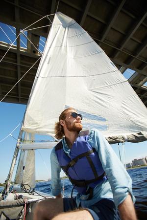 Sailor feeling freedom on boat