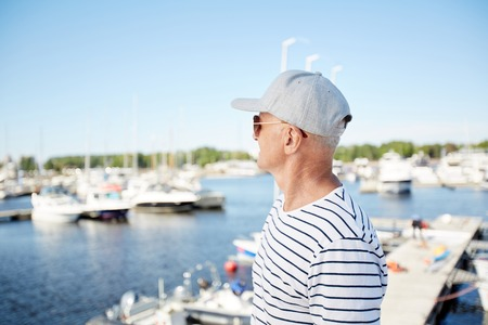 Mature man on vacation in yacht club Stock Photo