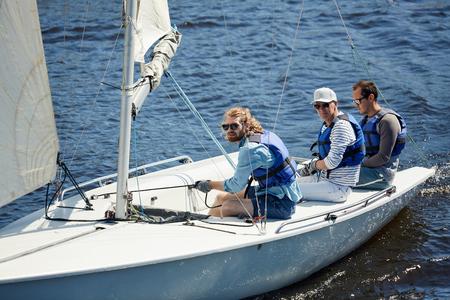 Serious men sailing on weekend Stock Photo