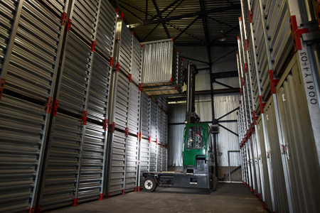 Forklift truck lowering container Stok Fotoğraf