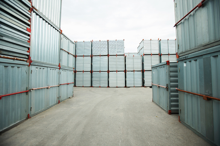 Abundance of sealed metal cargo containers stacking outdoors, shipping storage Stok Fotoğraf