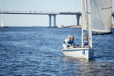 Three friends in sail boat