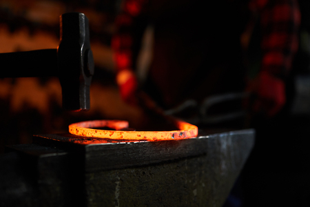 Hammer and molten metal
