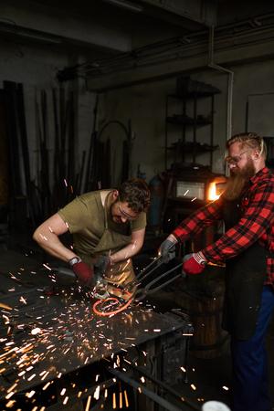 Teamwork of blacksmiths Фото со стока - 105109887