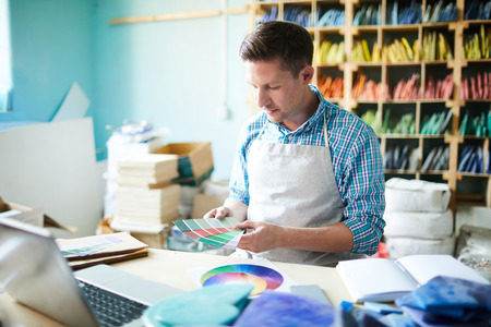 Artist Choosing Color Palette Stock Photo