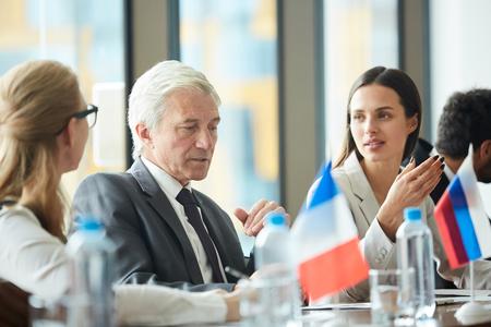 Thoughtful senior politician talking to colleagues Banco de Imagens