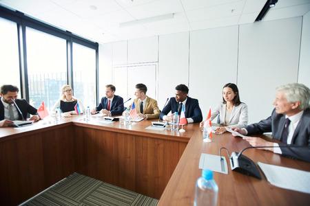 Consuls discussing future plans Banco de Imagens