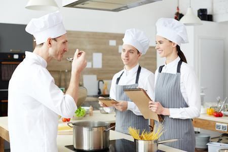 Tasting salt in water at cooking class Reklamní fotografie
