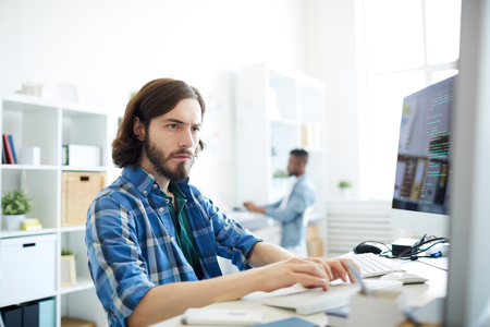Concentrated computer programmer in office