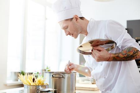 Stirring water in cooking pan Reklamní fotografie - 105504217