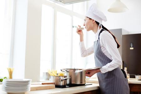Talented pasta maker cooking in restaurant kitchen
