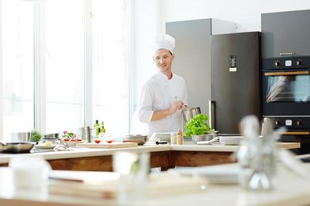 Smiling handsome cook at work Reklamní fotografie - 105504257