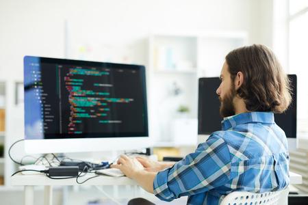Coder creating computer software