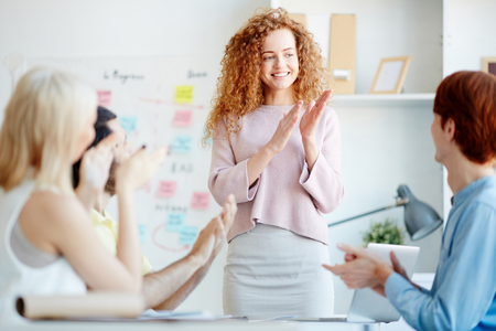 Positive colleagues applauding each other