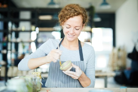 Woman making earthenware