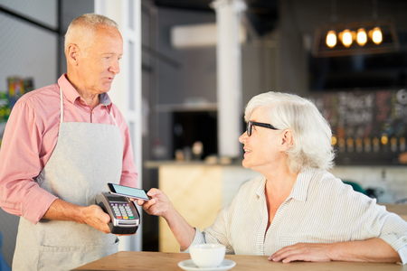 Paying after eating Stock Photo - 105555719