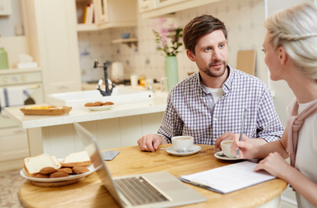 Couple making plans at breakfast Stock Photo