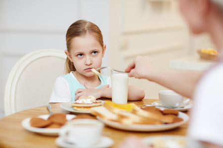 Girl refusing to eat Stock Photo