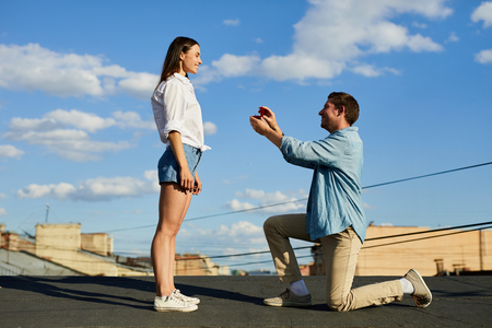 Unexpected proposal on roof Stock Photo