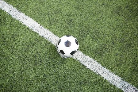 Soccer ball on dividing line