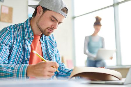 Guy making notes Stock Photo
