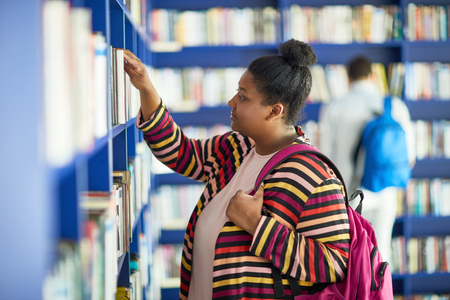 Fat African-American student in library